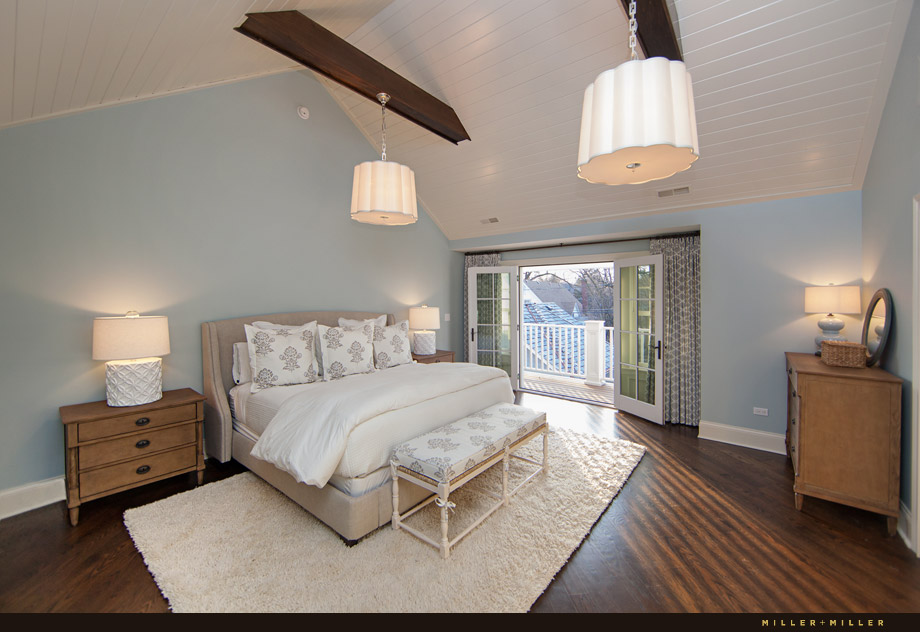 vaulted white plank ceiling contrasting dark beams