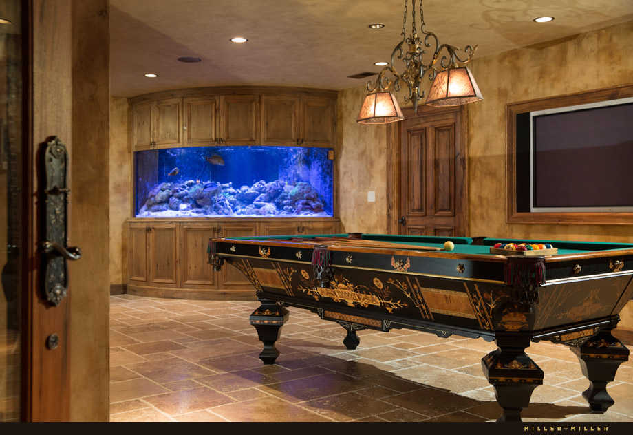 basement 500-gallon reef tank stone floors pool table