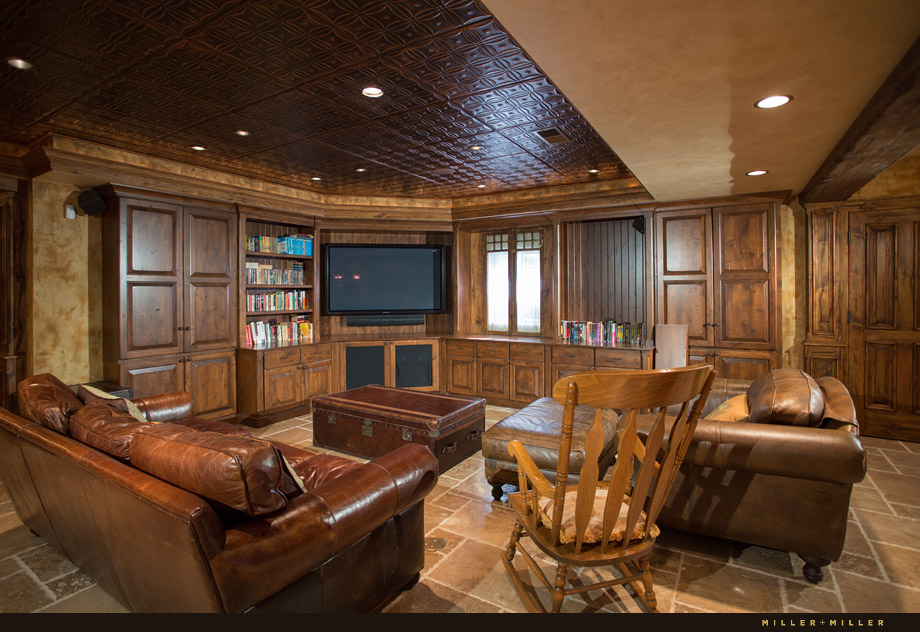 basement media theater room reclaimed wood cabinets