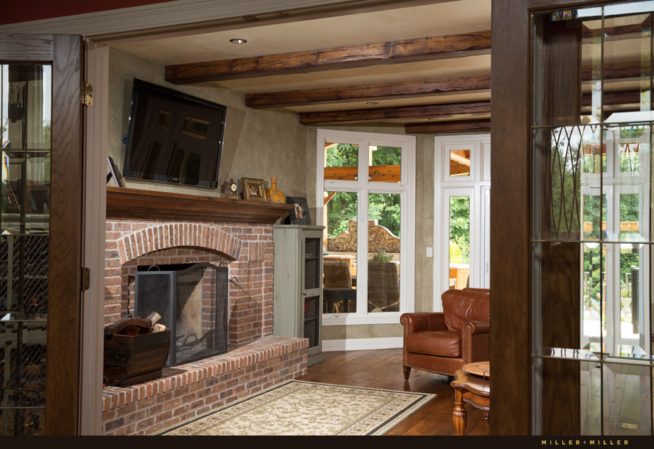 family room brick wood burning fireplace reclaimed beams ceiling