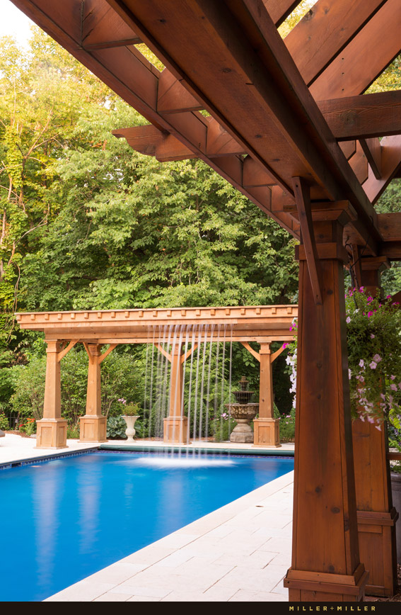 pergola cascading waterfall into pool