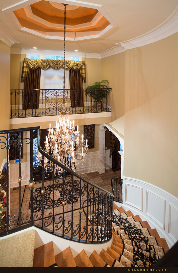 curved staircase large gold crystal chandelier