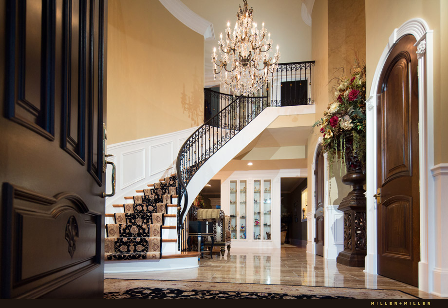 elegant gold foyer mahogany curved staircase